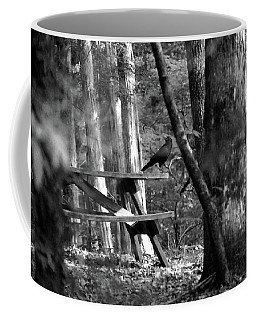 Crow On A Table Coffee Mug by Andy Lawless