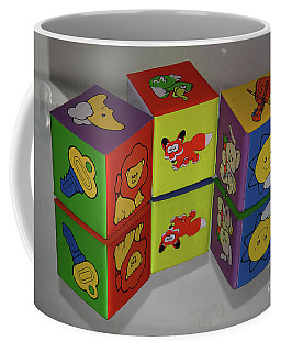 Coffee Mug featuring the photograph Cube Toys by Elvira Ladocki