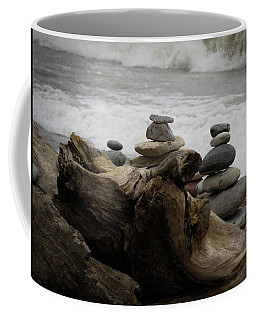 Coffee Mug featuring the photograph Driftwood Cairns by Kimberly Mackowski