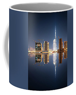 Fascinating Reflection Of Tallest Skyscrapers In Business Bay District During Calm Night. Dubai, United Arab Emirates. Coffee Mug