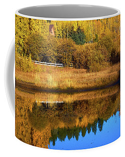 Coffee Mug featuring the photograph Golden Hour Relfections by John De Bord