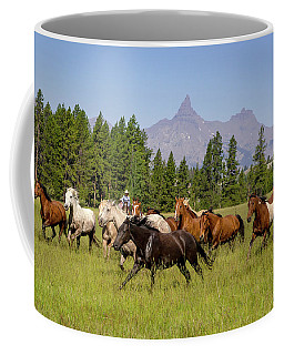 Coffee Mug featuring the photograph Head Em Up Move Em Out by Jack Bell