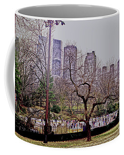Coffee Mug featuring the photograph Ice Skaters On Wollman Rink by Sandy Moulder