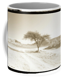 Coffee Mug featuring the photograph Lonely Tree by Arik Baltinester