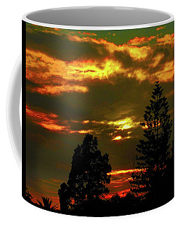 Coffee Mug featuring the photograph Ominous Sunset by Mark Blauhoefer