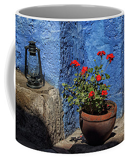 Coffee Mug featuring the photograph Red Geranium Near A Blue Wall by Patricia Hofmeester