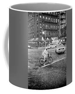 Coffee Mug featuring the photograph Rider In The Rain by Dave Beckerman