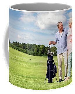 Senior Couple Enjoying Golf Game. Coffee Mug