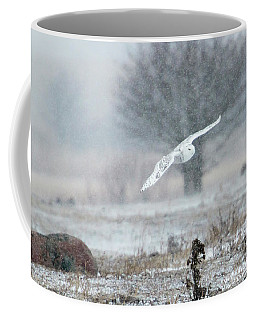 Coffee Mug featuring the photograph Snowy Owl In Flight by Gary Hall