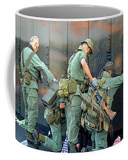 Coffee Mug featuring the photograph Veterans At Vietnam Wall by Carolyn Marshall