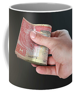 Hand Passing Wad Of Cash Coffee Mug