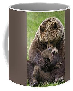 Mother Bear Cuddling Cub Coffee Mug