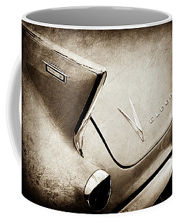 Coffee Mug featuring the photograph 1958 Cadillac Eldorado Biarritz Taillight Emblems -0255s by Jill Reger