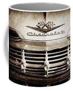 Coffee Mug featuring the photograph 1959 Chevrolet Impala Grille Emblem -1014s by Jill Reger