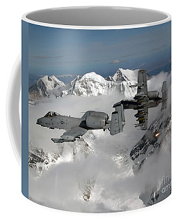 Coffee Mug featuring the photograph A-10 Thunderbolt IIs Fly by Stocktrek Images