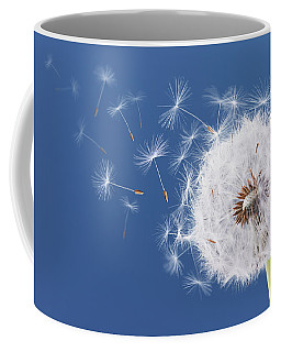 Dandelion Flying On Blue Background Coffee Mug