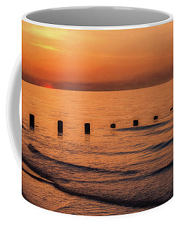 Coffee Mug featuring the photograph Golden Sunset by Adrian Evans
