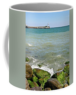 Lighthouse In Sea Coffee Mug by Irina Afonskaya