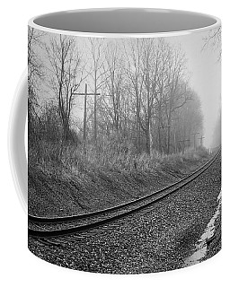 Coffee Mug featuring the photograph Tracks In Morning Fog by Lars Lentz