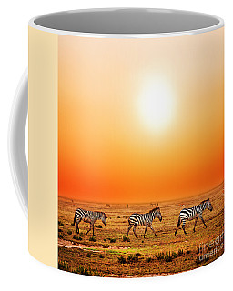 Zebras Herd On African Savanna At Sunset. Coffee Mug