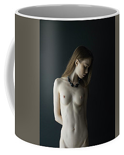 Young Woman In Front Of Black Wall Coffee Mug
