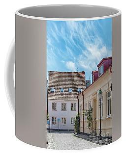 Coffee Mug featuring the photograph Ystad Street Scene by Antony McAulay