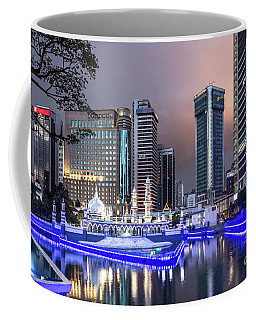 The Office Buildings Reflects In The Water Of The Klang River In Coffee Mug