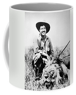 Coffee Mug featuring the photograph Ernest Hemingway by Granger
