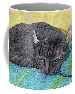 A Black Cat On The Back Of Sofa Coffee Mug