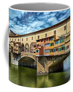 Ponte Vecchio On The Arno River Under A Blue Sky In Florence, Italy Coffee Mug