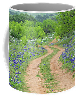 A Dirt Road Lined By Blue Bonnets Of Texas Coffee Mug