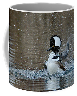 Coffee Mug featuring the photograph A Flurry Of Feathers by Fraida Gutovich