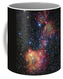 Coffee Mug featuring the photograph A Glowing Gas Cloud In The Large Magellanic Cloud by Eso