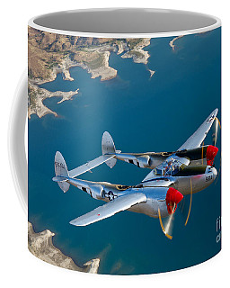 Coffee Mug featuring the photograph A Lockheed P-38 Lightning Fighter by Scott Germain