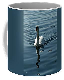 A Lone Swan Swims Through The Water Coffee Mug
