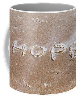 Coffee Mug featuring the photograph A Message On The Beach by John M Bailey