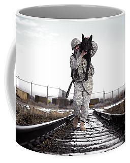 A Military Dog Handler Uses An Coffee Mug