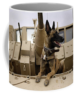 Coffee Mug featuring the photograph A Military Working Dog Sits On A U.s by Stocktrek Images