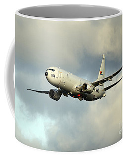 Coffee Mug featuring the photograph A P-8a Poseidon In Flight by Stocktrek Images