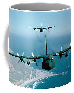 Coffee Mug featuring the photograph A Pair Of C-130 Hercules In Flight by Stocktrek Images