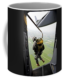 Coffee Mug featuring the photograph A Paratrooper Executes An Airborne Jump by Stocktrek Images
