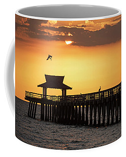 A Pelican Dive-bomb At The Naples Pier Naples Fl Coffee Mug