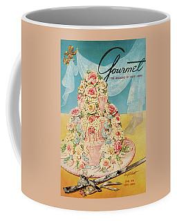 A Pink Wedding Cake And Ceremonial Silver Cutting Coffee Mug