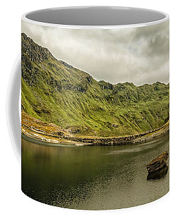 Coffee Mug featuring the photograph A Rock And A Hard Place by Nick Bywater