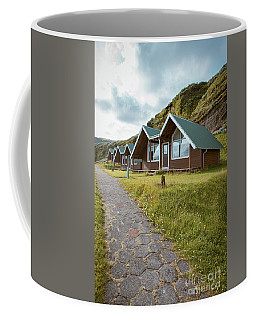 Coffee Mug featuring the photograph A Row Of Cabins In Iceland by Edward Fielding