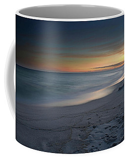 Coffee Mug featuring the photograph A Sandy Shoreline At Sunset by Renee Hardison