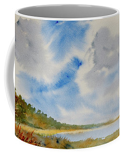 A Secluded Inlet Beneath Billowing Clouds Coffee Mug