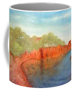A Small Inlet Bay With Red Orange Rocks Coffee Mug
