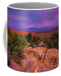 Coffee Mug featuring the photograph A Sunset Over Arches by John De Bord