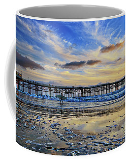 A Surfer Heads Home Under A Cloudy Sunset At Crystal Pier Coffee Mug